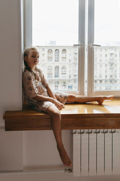 A young girl at the big window.