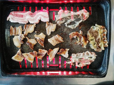 Korean BBQ. Raw meat on a Korean stove
