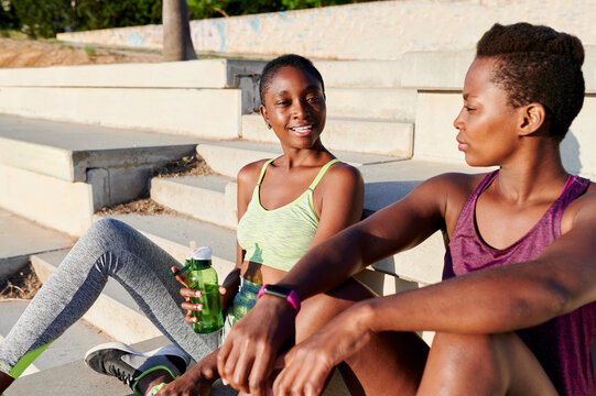 Friends talking during a break from running