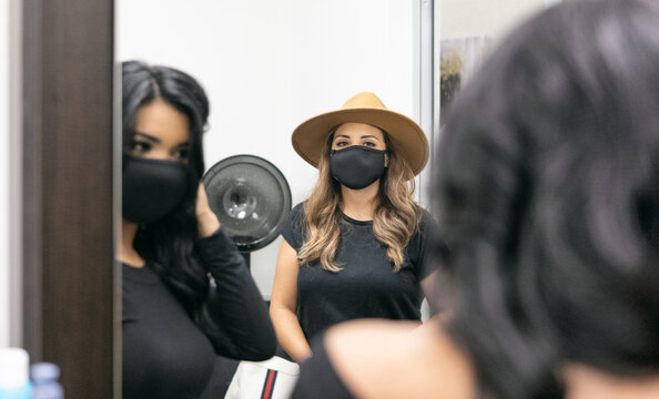Style: Customer Wearing Mask Admires New Hairdo In Mirror