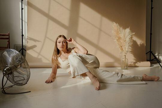beautiful girl posing in the Studio in beige