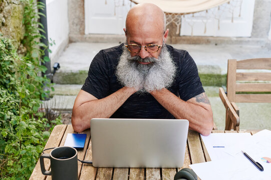 Mature man working from home using a laptop