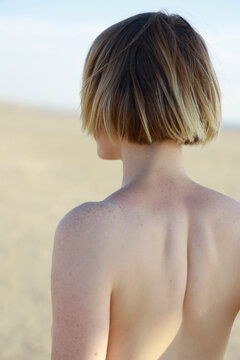 back of woman with short hair