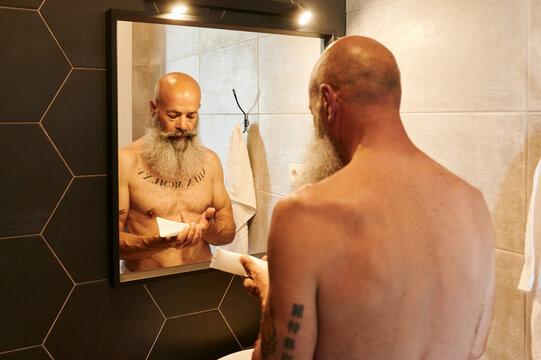 Mautre man getting ready in his bathroom