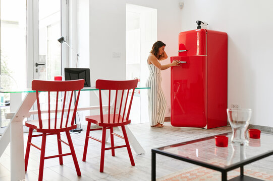 Woman looking in her fridge