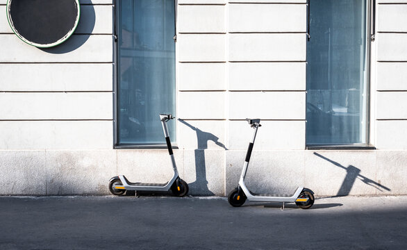 Electric urban scooter parked in the street in the city