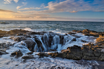 Thor's Well with surf cascading into the well along the Oregon coastline Wall mural