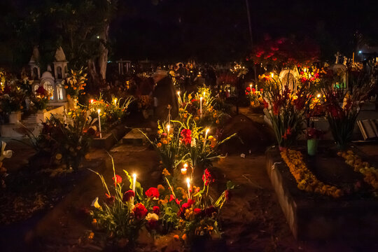Marigolds and Festive Candles Decorate an Old Graveyard