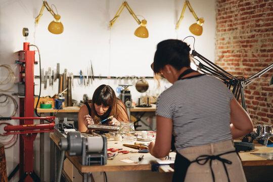 Coworkers in Artisan Workshop