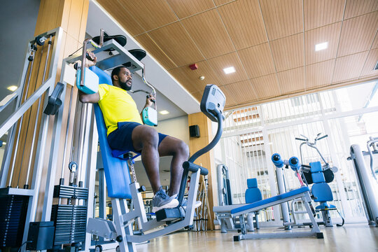 Man in yellow T-shirt on exercise machine