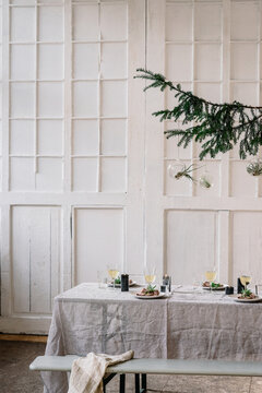 Christmas table decorated for dinner with friends or family indoors
