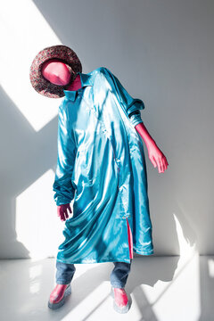 Faceless model in creative colorful garment in studio