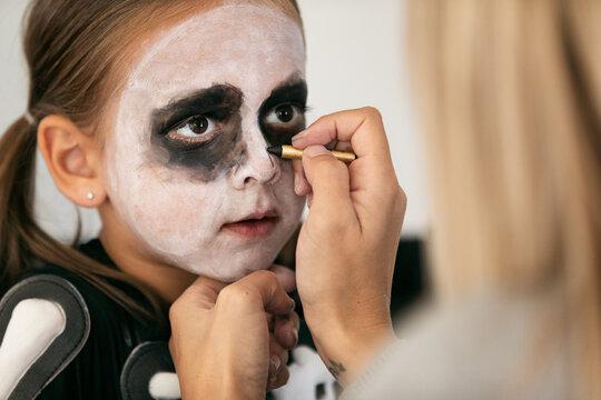 Skeleton: Mother Using Black Makeup Crayon