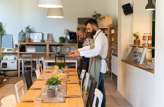 Chefs Near To The Table In Restaurant