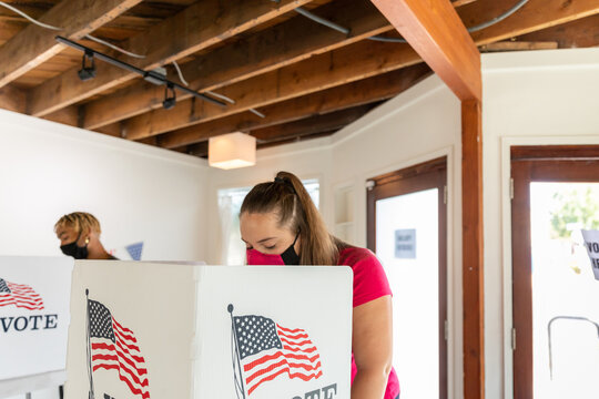 Caucasian Female in Foreground, Voting in American Election
