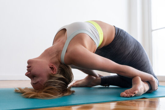 woman doing yoga stretch at home