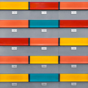 Multicolored modern mailboxes with numbers