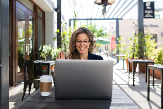 Woman Communicates with Team Virtually