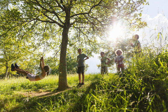 Children play together outdoors
