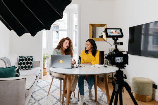 Ethnic women recording podcast together