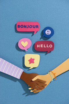 Hello greeting in languages and group of diverse people.