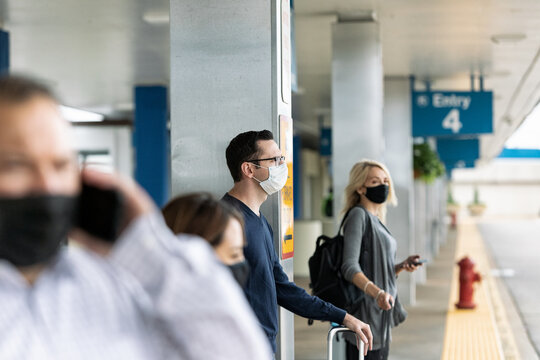 Travel: People Outside Of Airport Wait For Rideshare Rides
