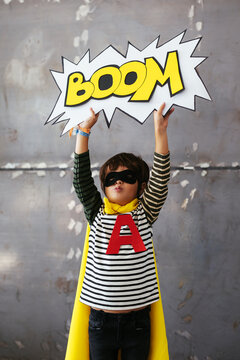 Cute superhero with Boom speech bubble over head