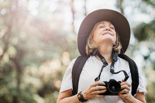 Active elderly woman breathing in fresh air