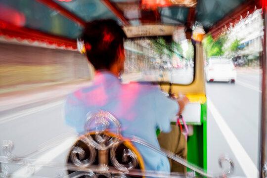 Tuk tuk taxi driver in Bangkok, Thailand.