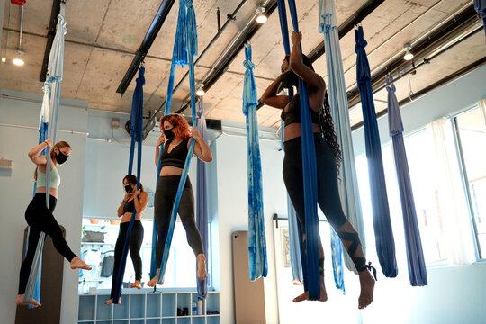 Mindfulness woman aerial silk class group during coronavirus pandemic.