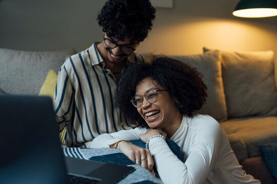 Young Black Couple using a Laptop at Home