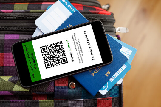 passport and a smart phone with a digital of a certificate of vaccination against the Covid-19 disease.