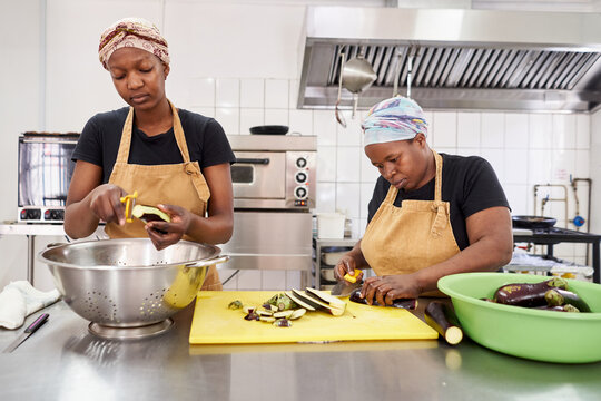 Women preparing food in a catering kitchen