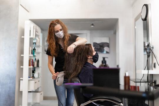 hairdresser preparing hair for cutting