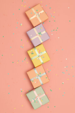 Pastel presents wrapped in pastel ribbons and confetti