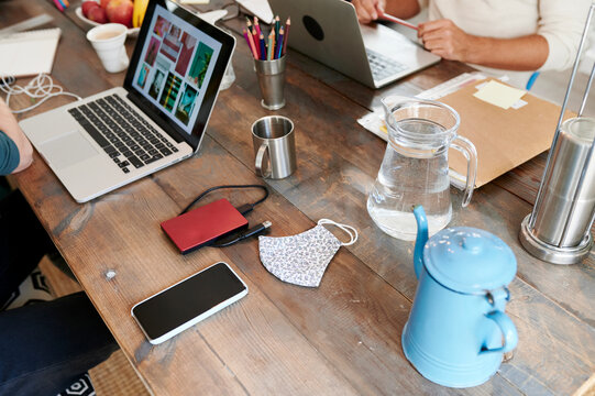 Designers working at a table in an office