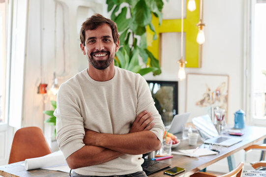 Smiling designer standing in an office