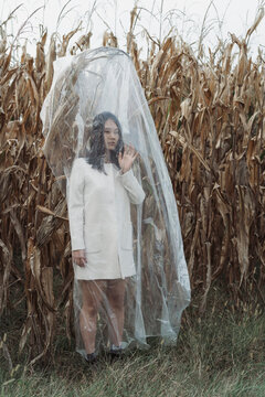 Asian woman In Nature Covered With Plastic. Isolation