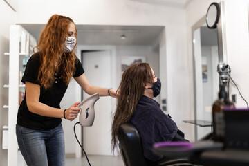 hairdresser preparing hair for cutting Wall mural
