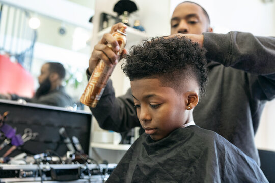 Barber: Stylist Applies Conditioning Hairspray