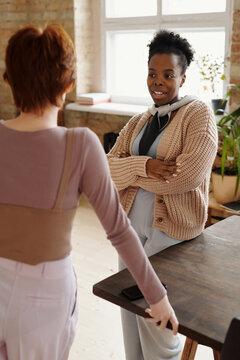 Interracial women chatting in modern office
