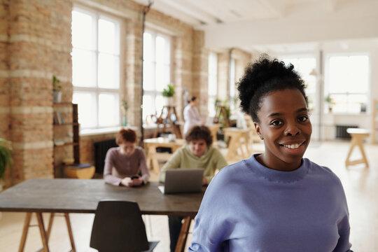 Portrait of smiling black woman in loft office
