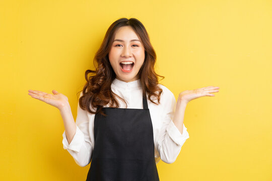 Beautiful housewife with gesture isolated on yellow background