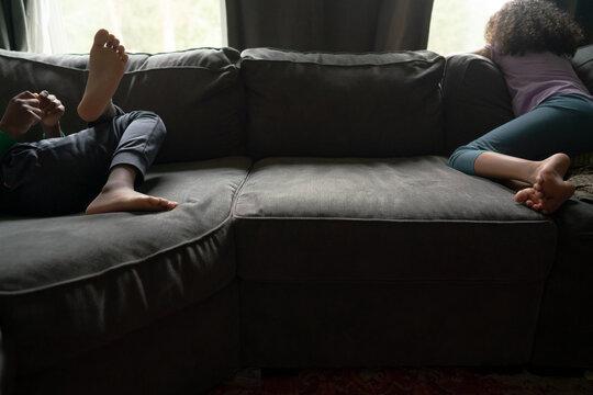 Children sprawled on couch