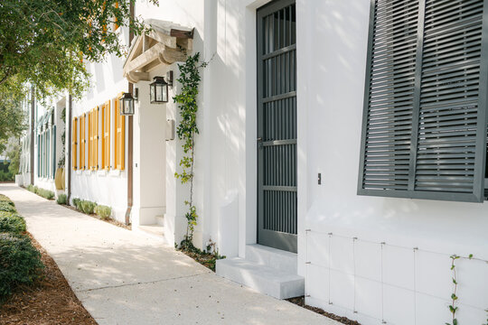 Colorful coastal townhome shutters