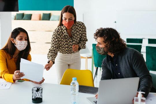 Startup team brainstorming in creative workspace