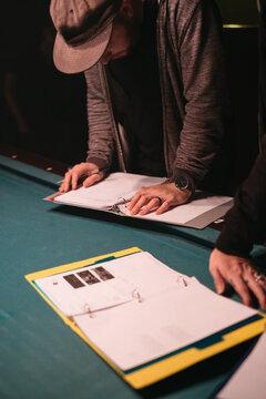 A film crew member reviews a script