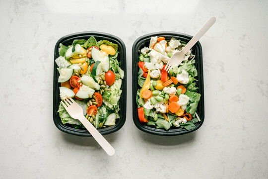 Salad containers prepped for healthy meal planning