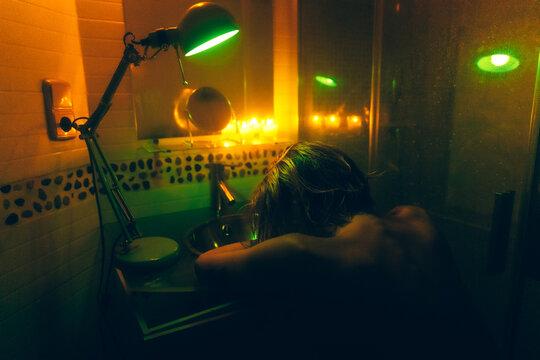 woman in a neon bathroom
