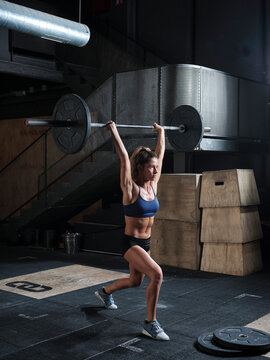 Athlete woman weightlifting in the fitness gym